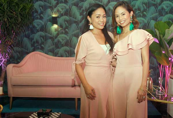 Moss Manila Home founders, designers and sisters Cyndi Fernandez-Beltran and Happy Fernandez-Victorino at the launch of their third-anniversary collection. Behind them is the Palm Springs sofa in blush pink. Photo by BENING BATUIGAS