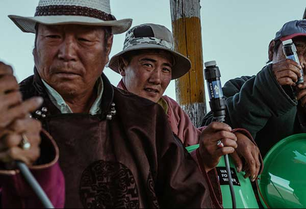 The Waves For Water team demonstrates the assembly of our buckets, while one young Mongolian represents his village among elders. photos by Artu Nepomuceno
