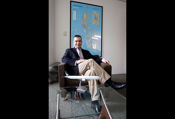 """Robin """"Rob"""" Bradshaw, Cathay Pacific Philippines country manager: The Philippine map on his office wall guides him on his local wish list. Photo by BENING BATUIGAS"""