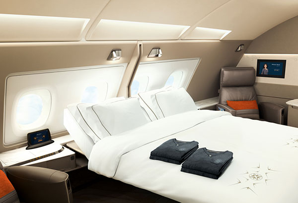The new Singapore Airlines A380 First Class Suites feature double beds with seats upholstered in Poltrona Frau leather and pajamas and bed linens by Lalique. The first of five new A380s will start flying on Dec. 18 to Sydney as its first route.