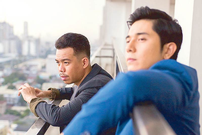 Looking up: Director JP Habac and actor Paulo Avelino talk feelings and alcohol in the film I'm Drunk, I Love You. Photo by Geric Cruz