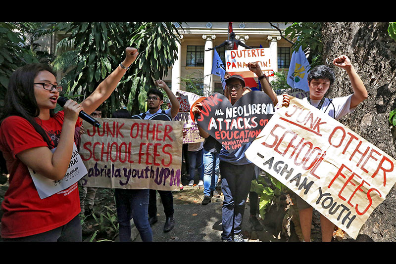 Students from the University of the Philippines campus in Manila stage a walkout in February to call for free education for all. EDD GUMBAN, file