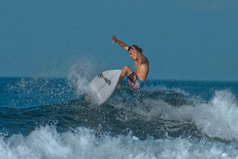 Riding the waves in Siargao. GEORGE TAPAN