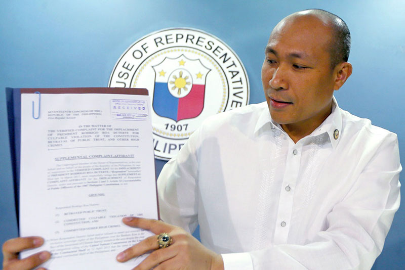Rep.Gary Alejano shows the supplemental impeachment complaint he filed against President Duterte at the House of Representatives yesterday. AP