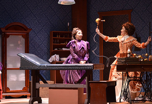 """Tinkering away: """"The machine"""" in Repertory Philippines' rendition of The Vibrator Play looks as if it was improvised from household items."""