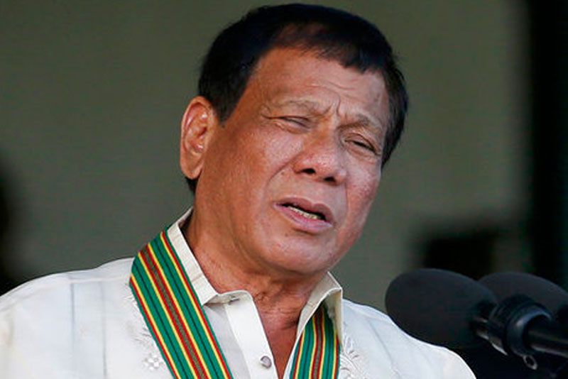 In this Tuesday, April 4, 2017 file photo, Philippine President Rodrigo Duterte gestures while addressing army troopers during the 120th anniversary celebration of the Philippine Army at Fort Bonifacio in suburban Taguig city, east of Manila, Philippines.  AP Photo/Bullit Marquez, File