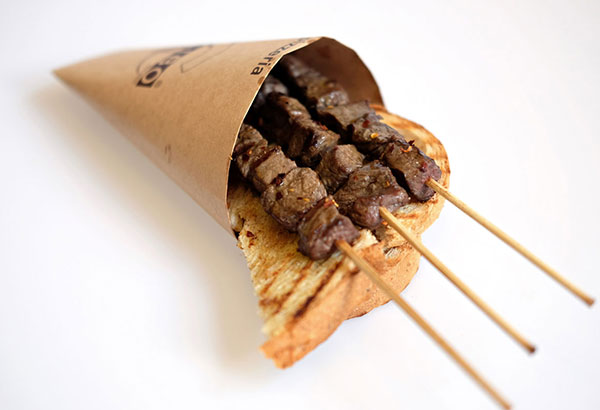 Abruzzo-style: Arrosticini is skewered beef tenderloin cubes spiked with chili flakes on Tuscan whole wheat bread loved by the rustic town's locals and foodie tourists alike.