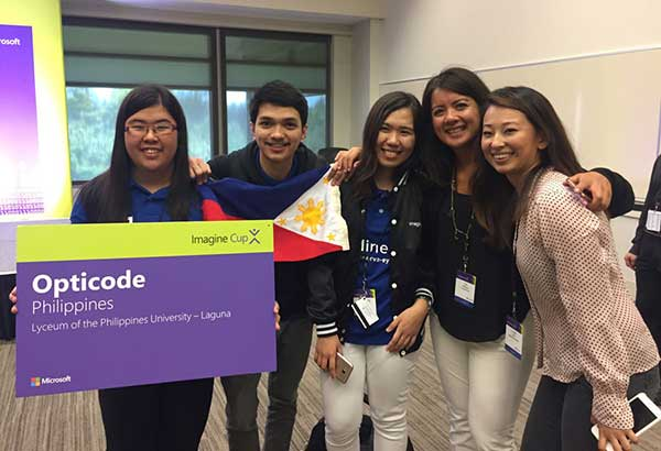To see is to believe: Team Philippines (composed to Rochel Reyes, Christian Cepe, and Jasmine Raymundo) celebrate reaching the semifinals of Microsoft's Imagine Cup with two of the judges of their last panel presentation.