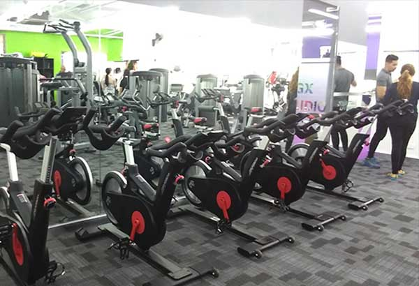 Get fit, fam: Watch Netflix while working out at the Anytime Fitness Glorietta 5 branch.