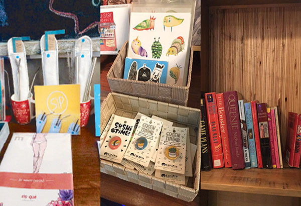 Knick knacks: Buku-Buku Kafé has a table full of stickers, zines, and other craft items for sale.