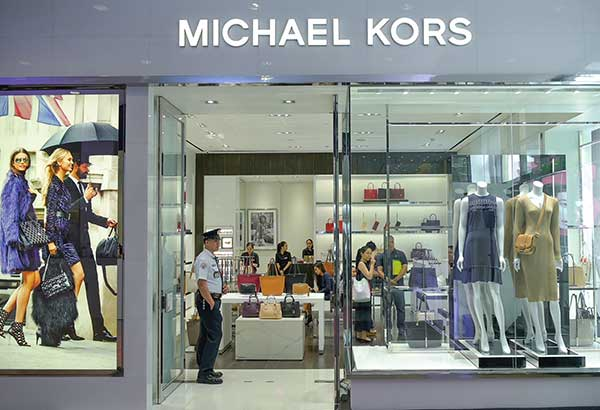The newly renovated Michael Kors flagship store in Makati gets an upgrade with its play on metal accents seen on shelves and fixtures.