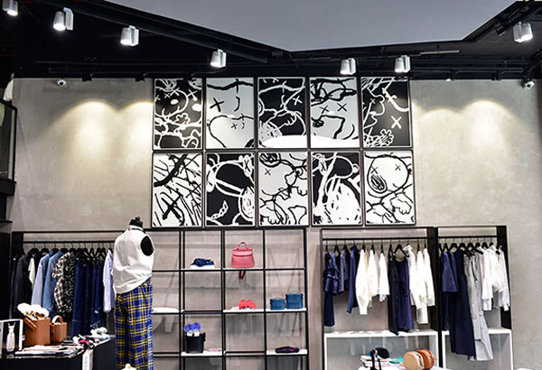 Be Distinqt: Noble House's contemporary luxury multi-brand lifestyle boutique is now open. Artwork by Kaws in the women's floor.