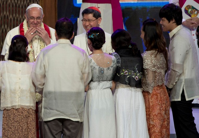 Pope Francis Reacts While Meeting A Hearing Impaired Father And His Family At The Mall Of Asia Arena In Manila Philippines Friday Jan 16 2015