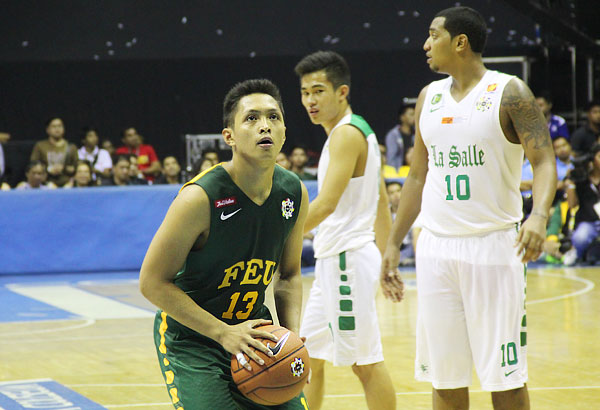 Mike Tolomia scattered 23 points in the FEU Tamaraws' win over the La Salle Green Archers in the opening day of 77th UAAP men's basketball tournament at the Smart Araneta Coliseum on Sunday. AJ BOLANDO