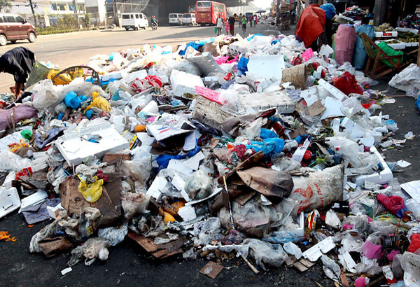 In this file photo, garbage is piled along EDSA near the Light Rail Transit station in Balintawak, Quezon City. The STAR/Boy Santos