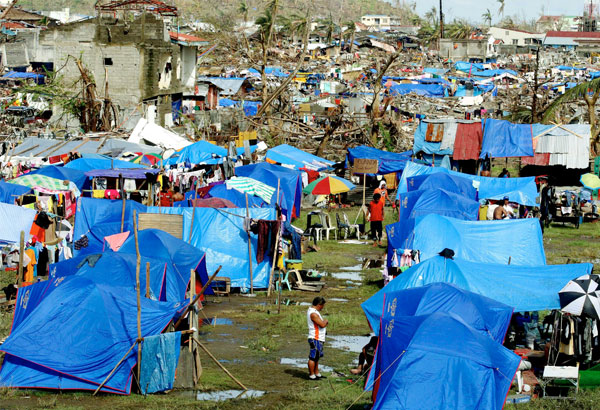 Tacloban City residents put up makeshift houses and tents after being devastated by supertyphoon Yolanda in 2013.