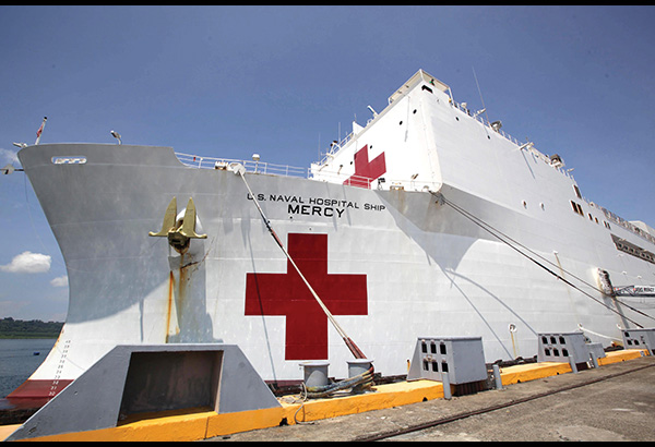The USNS Mercy docks at the Subic Bay Freeport yesterday to conduct humanitarian and relief missions. Ernie Peñaredondo