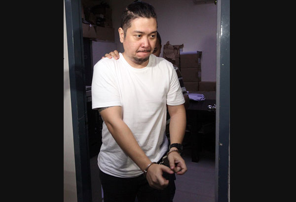 Domingo de Guzman is brought to the National Bureau of Investigation headquarters in Manila following his arrest at a hotel in Dasmariñas, Cavite Thursday night. BERNARDO BATUIGAS
