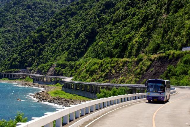 In this November 2012 photo, a passenger bus transits the Patapat Viaduct in Pagudpod, Ilocos Norte. Ilocos Norte gov't/Released