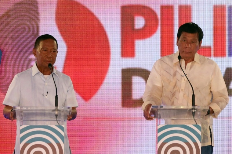 Presidential candidates Vice President Jejomar Binay and Davao City Mayor Rodrigo Duterte participate in the second of the scheduled three presidential debates Sunday, March 20, 2016 in Cebu City. The country will hold its presidential elections on May 9, 2016. KJ Rosales, Pool Photo via AP