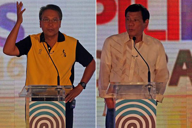 Presidential candidates Rodrido Duterte and Mar Roxas participate in the second round of the three presidential debates on Sunday, March 20, 2016 in Cebu City. STAR / KJ Rosales
