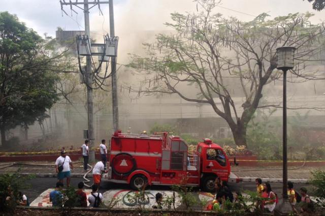 """The Bureau of Fire Protection declared """"fire out"""" at the Faculty Center of the University of the Philippines Diliman at around 11:45 a.m.Philippine Collegian"""