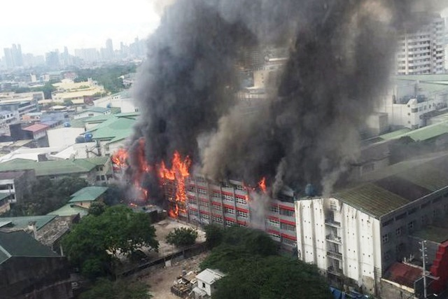 In this photo by the University of the East Journalism Society, fire is seen from a building of the University of the East campus on Recto Street in Manila, Philippines on Saturday, April 2, 2016.