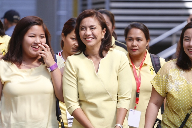 Liberal Party bet Leni Robredo arrives with her daughters at the venue of the vice presidential debate on Sunday, April 10, 2016 at the University of Santo Tomas in Manila. Philstar.com / Efigenio Toledo IV