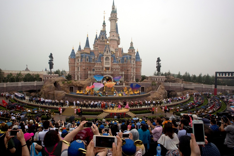 Performers take to the stage during the opening ceremony for the Disney Resort in Shanghai, China, Thursday, June 16, 2016. Walt Disney Co. opened its first theme park in mainland China on Thursday at a ceremony that mixed speeches by Communist Party officials, a Chinese children's choir and actors dressed as Sleeping Beauty and other Disney characters. AP/Ng Han Guan