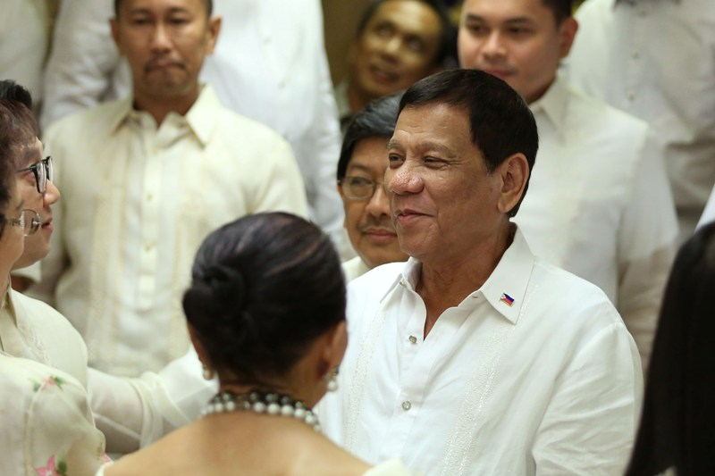 President Duterte is mobbed by members and officials of the League of Provinces and League of Cities of the Philippines after delivering his speech at the Heroes' Hall at Malacañan on Wednesday evening, July 27, 2016. PPD/Kiwi Bulaclac