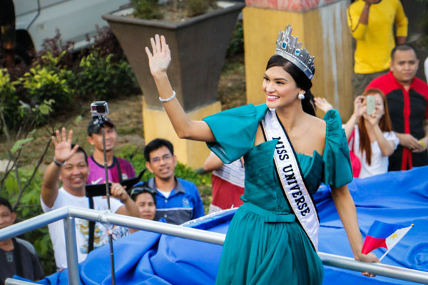 Six of Philippines's tourist destinations will be featured in the 65th Miss Universe pageant, including the provinces of President Rodrigo Duterte and Miss Universe 2016 Pia Wurtzbach. Wurtzbach is seen in this January 2016 photo waving to supporters at her homecoming parade after winning the coveted crown in Las Vegas. Philstar.com / Efigenio Toledo IV