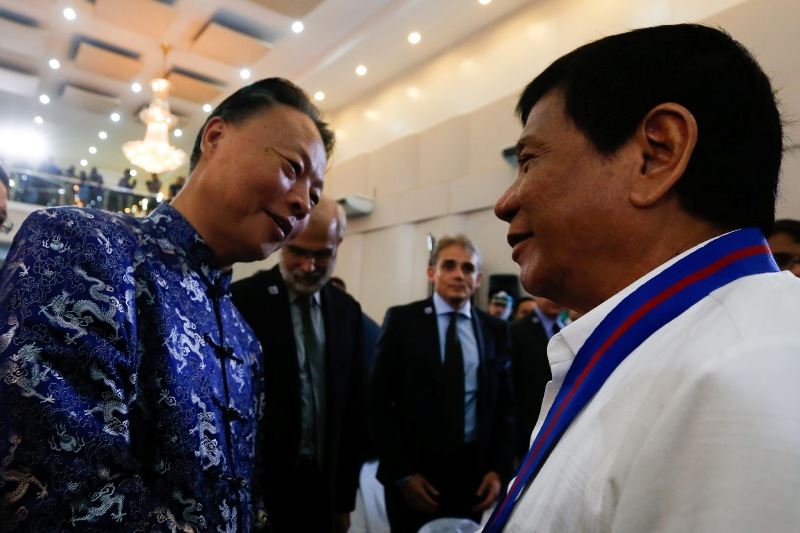In this Aug. 17, 2016 photo, President Rodrigo Duterte chats with Chinese Ambassador to the Philippines Zhao Jianhua at the 115th anniversary of the Philippine National Police in Camp Crame. PPD/Toto Lozano