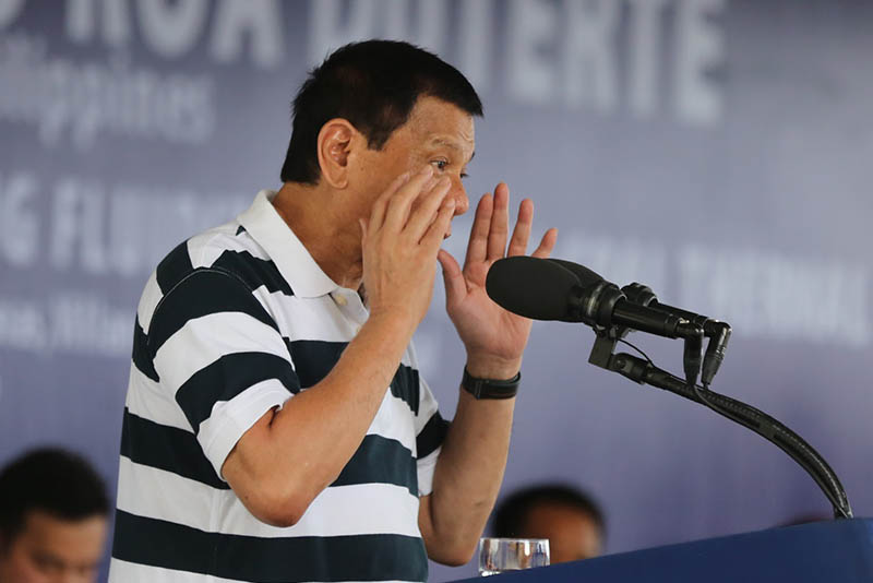 In this Sept. 22, 2016 phoot, President Rodrigo Duterte challenges the United Nations special rapporteur to come to the Philippines and probe the alleged extrajudicial killing activities in the country, during his speech at the inauguration of the Filinvest Development Corporation Misamis 3x135 MW circulating fluid bed coal thermal plant in Villanueva, Misamis Oriental. PPD/King Rodriguez