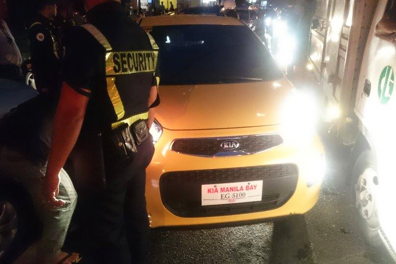 A viral video originally posted on Facebook shows a driver crashing her yellow KiaPicantocar into vehicles and Rockwell marshals in Makati City. Facebook/KittLapeña
