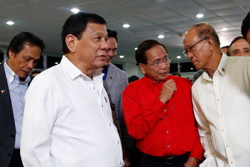 President Rodrigo Duterte chats with members of his Cabinet after his speech at the Francisco Bangoy International Airport in Davao City on Nov. 23, 2016. PPD
