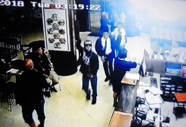 Two of four armed men are seen in an image taken from The Mabuhay Manor's closed-circuit television footage of yesterday's robbery. Edd Gumban