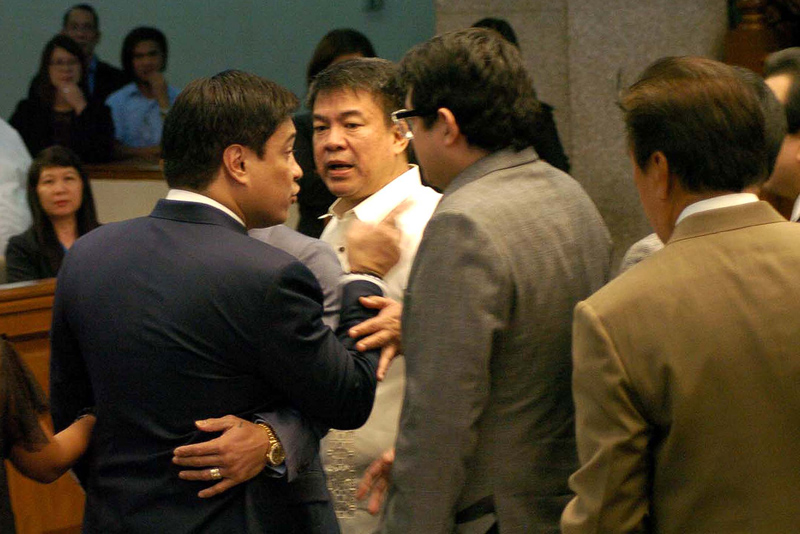 Senate President Aquilino Pimentel III (2nd from left) suspended plenary session and tries to pacify a heated argument between Sens. Juan Miguel Zubiri (left) and Antonio Trillanes IV (hidden at right) on Tuesday (Jan. 17, 2017) at the Senate in Pasay City. Also in photo are Sens.  Paolo Benigno Aquino IV and Senate Majority Floor Leader Vicente Sotto. PNA/Avito Dalan