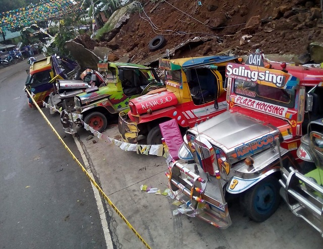 Landslide covers vehicles parked in mountain barangay of Busay in Cebu City earlier today. The Freeman/Aldo Banaynal