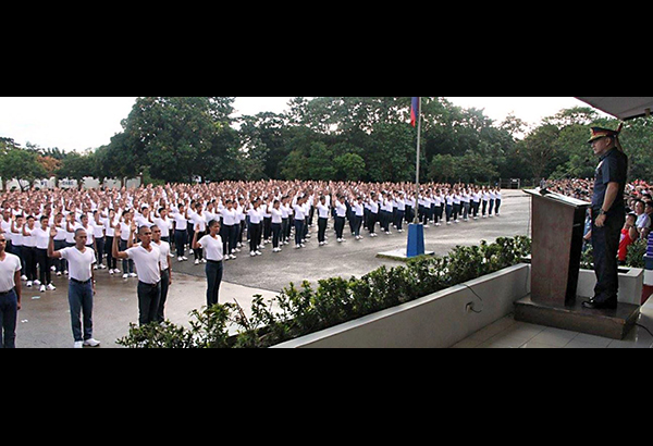 NCRPO chief Director Oscar Albayalde swears in new recruits in a ceremony at Camp Bagong Diwa on Thursday.