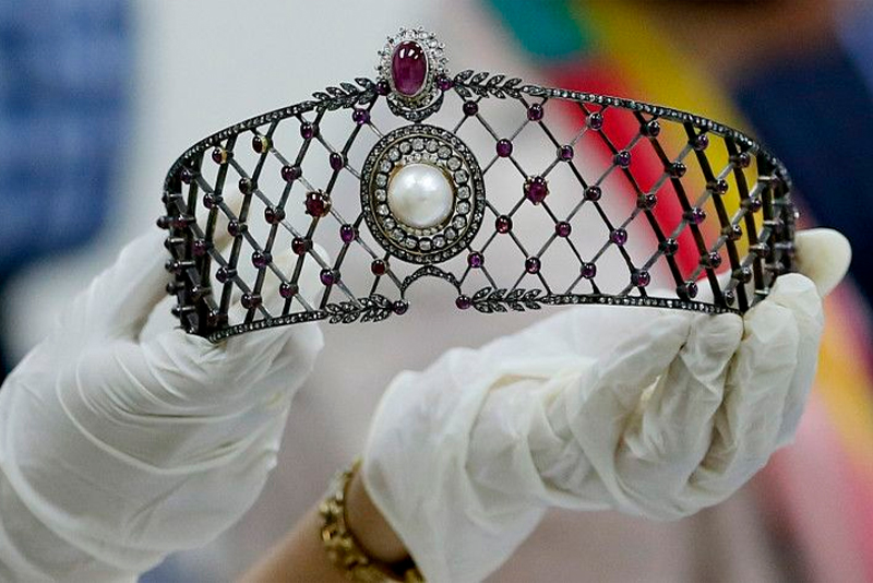 In this Nov. 27, 2015 file photo, an official of the Presidential Commission on Good Government holds a set of jewelry from the so-called Hawaii Collection, one of three sets of the Marcos Jewelry Collection, during appraisal by Sotheby's at the Central Bank of the Philippines in Manila, Philippines. AP/Bullit Marquez