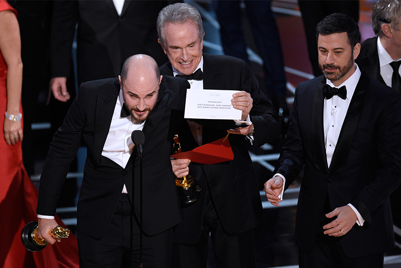 "Jordan Horowitz, producer of ""La La Land,"" shows the envelope revealing ""Moonlight"" as the true winner of best picture at the Oscars on Sunday, Feb. 26, 2017, at the Dolby Theatre in Los Angeles. Presenter Warren Beatty and host Jimmy Kimmel look on from right. Chris Pizzello/Invision/AP"