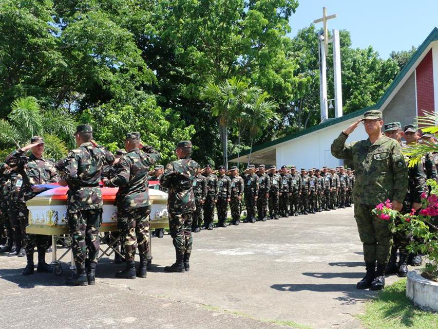 Army and Marine officers led the traditional military honors for slain Marine Private Albino Bahian III at Camp Siongco in Maguindanao. Philstar.com/John Unson