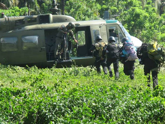 Combat-ready commandos of the South Cotabato provincial police approach a helicopter that would take them to Barangay Tablu in Tampakan town to reinforce Army units now fighting New People's Army guerillas harassing villages there.Photo from South Cotabato Provincial Police Office