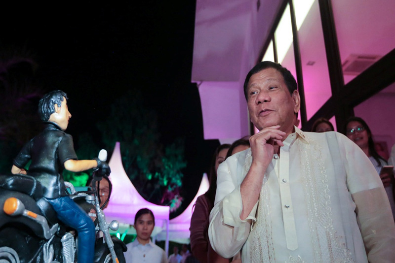 President Rodrigo Duterte delivers a message during the 70th birthday celebration of former President and incumbent Pampanga 2nd District Representative Gloria Arroyo at La Vista Subdivision in Quezon City on April 5, 2017, where the celebrant Arroyo presents a post-birthday cake to President Duterte who celebrated his birthday on March 28, 2017. PPD/Albert Alcain, file