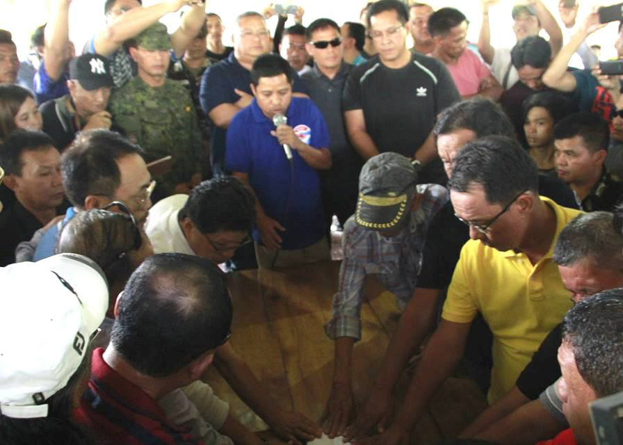 Leaders of the Balindong and Montañer clans swear over the Qur'an to live again in peace after fighting each other for two decades. Courtesy 6th Infantry Division, Philippine Army
