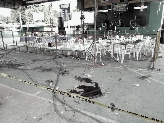 Blood scattered around the crime scene in a covered court in Barangay Sampaga, Balayan, Batangas. The Filipino Connection