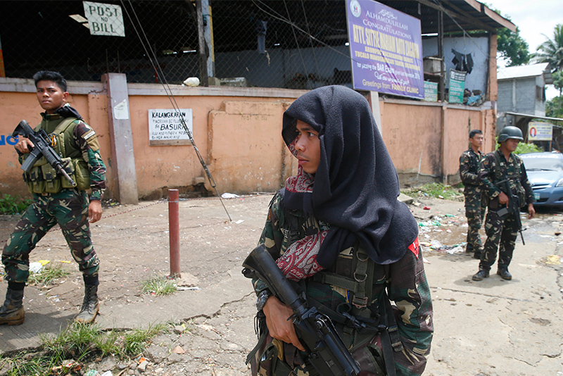 Government troops patrol the streets of Marawi city three days after Muslim militants lay siege in the city in southern Philippines Thursday, May 25, 2017. AP/Bullit Marquez