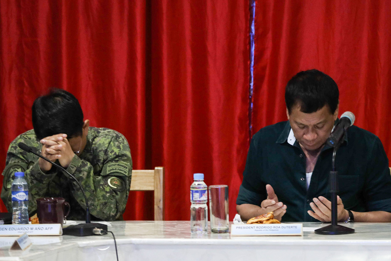 President Rodrigo Duterte attends a situation briefing at the 2nd Mechanized Infantry Brigade headquarters in Iligan City on May 26, 2017. PPD