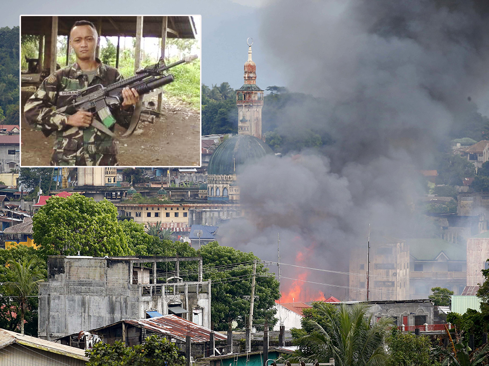 Photo inset shows Army Private 1stClass Kevin Sisiban, one of 11 soldiers killed in government airstrike that went awry in Marawi Cityon Wednesday.Philippine Army and AP photos