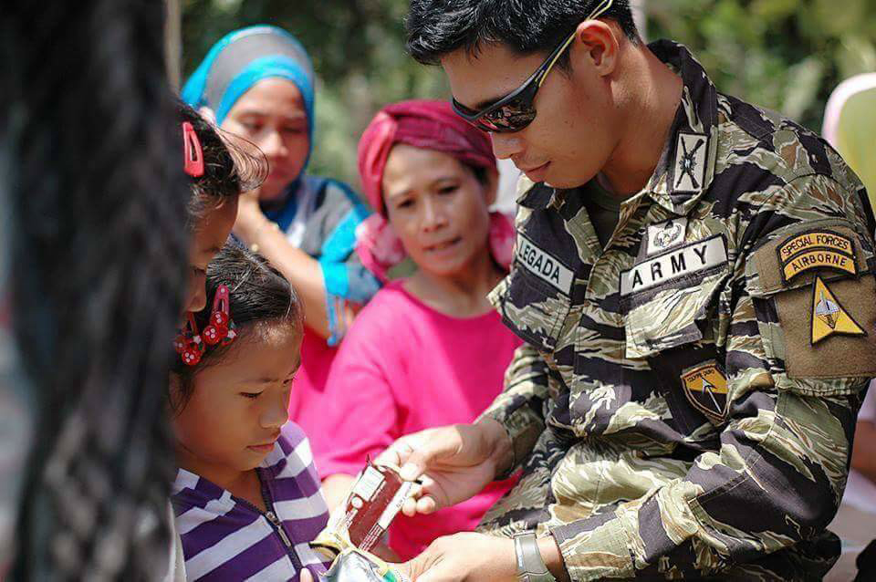 1Lt. Junrich Legada during one of the recent humanitarian missions of their unit.Photo courtesy of Legada family